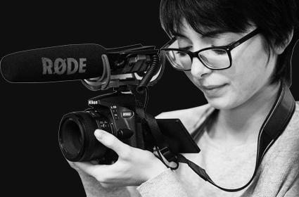 Video Editor Madeleine Philbrook holds camera